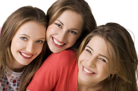Portrait of three young beautiful  happy girls