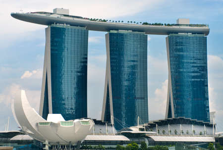 SINGAPORE-AUGUST 21:The Marina Bay Sands Resort August 21, 2011 in Singapore. The roofs of towers are decorated with a park in the form of a ship 340 m long and capacity up to 3,900 people.
