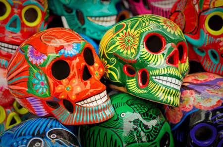 Photo pour Decorated colorful skulls, ceramics death symbol at market, day of dead, Mexico - image libre de droit