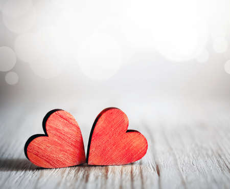 Foto de Valentines day background with two red hearts on wooden background - Imagen libre de derechos