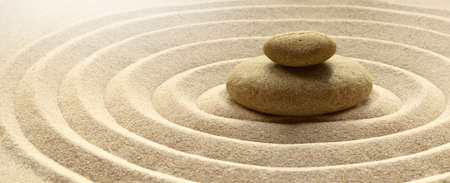 Foto de zen garden meditation stone background with stones and lines in sand for relaxation balance and harmony spirituality or spa wellness. - Imagen libre de derechos