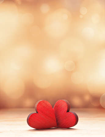 Photo pour Two Red Wooden Hearts. Valentines day concept. - image libre de droit