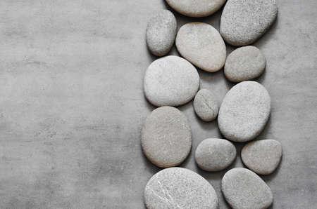 Photo pour Gray spa stones and grey background. Spa concept. - image libre de droit