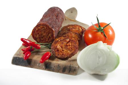 Hungarian homemade paprika salami with vegetables