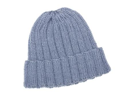 Foto de Gray woolen hat isolated on white - Imagen libre de derechos