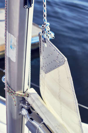 Sail attached to the rope by bowline on yacht.