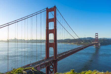 Photo for Golden Gate Bridge at sunrise and blue sky in San Francisco, USA - Royalty Free Image