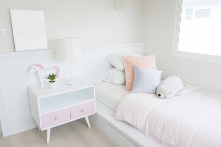 Photo for modern kid's bedroom and dolls on bed with wooden bed, interior decoration design concept - Royalty Free Image