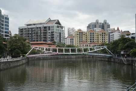 Photo for Alkaff Bridge on the Singapore River at Robertson Quay with dark gray clouds - Royalty Free Image