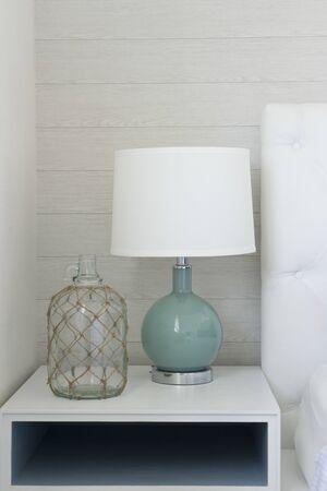 Foto de modern white table lamp beside sofa in living room. - Imagen libre de derechos