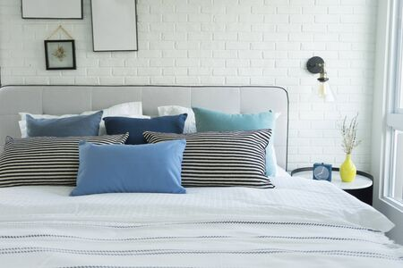 Photo pour White and blue spacious bedroom with a large bed, in the Scandinavian style. Mockup and free space for text and pictures - image libre de droit