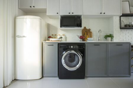 Photo pour Interior of modern kitchen with washing machine. Laundry day - image libre de droit