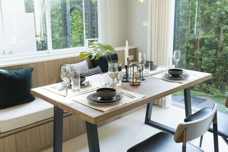 Photo pour Modern dinning room interior with grey plate on wood table at home. - image libre de droit
