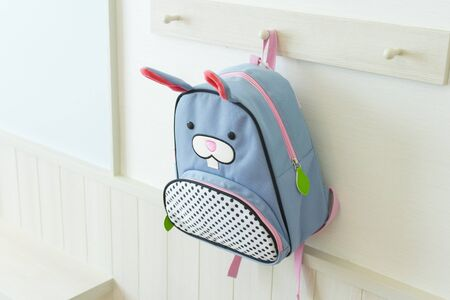 Photo pour blue school rucksack hanging on the wall in kid bedroom. - image libre de droit