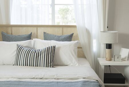 Photo pour The bedroom in a Scandinavian minimalist natural style. Gray pillows on the bed. - image libre de droit