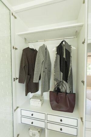 Photo pour Stylish clothes and home stuff in large wardrobe closet. - image libre de droit