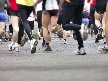 Long distance runners in closeup, shallow focus
