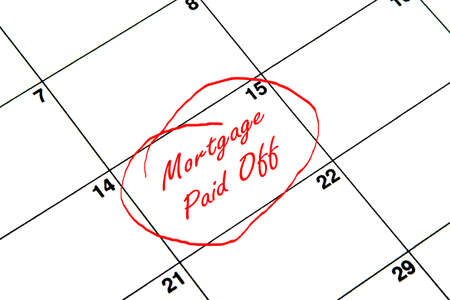 Photo pour Mortgage Paid Off Circled on A Calendar in Red - image libre de droit
