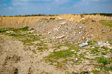 Builder's rubble illegally dumped in the countryside