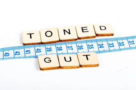 Photo for Health concept of a tape measure also showing the message Toned Gut - Royalty Free Image