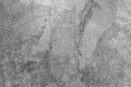 Texture of the gray polished concrete wall with scratches