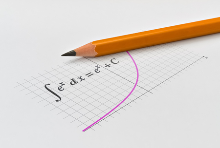 Photo pour Yellow pencil and integrating the exponential function with its graph - image libre de droit