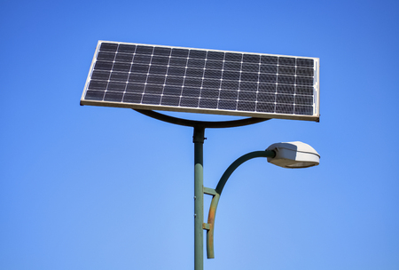 Photo for Solar panel and street lamp with clear blue sky in the background - Royalty Free Image