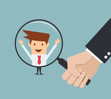business man hand holding magnifying glass for search a man. Recruitment or selection concept.