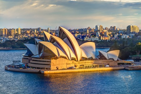 Sydney, New South Wales, Australia - December 29, 2014: Profile of Sydney Opera House at sunset seen from Sydney Harbour Bridge