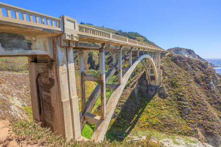Prospective view of iconic Bixby Bridge on Pacific Coast Highway Number 1 in California, United States.Bixby Bridge is located near Pfeiffer Canyon Bridge collapsed in Big Sur. American travel concept