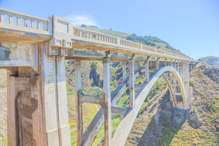 Iconic Bixby Bridge on Pacific Coast Highway Number 1 in California, United States.Bixby Bridge is located near Pfeiffer Canyon Bridge collapsed in Big Sur. American travel concept. Soft light.