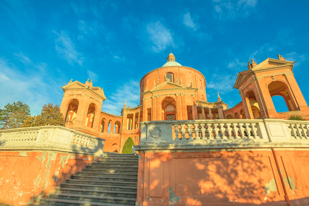 Photo for Entrance of Sanctuary of Madonna di San Luca in a sunny day with blue sky. Basilica church of San Luca in Bologna, Emilia-Romagna, Italy. Famous landmark cityscape. - Royalty Free Image
