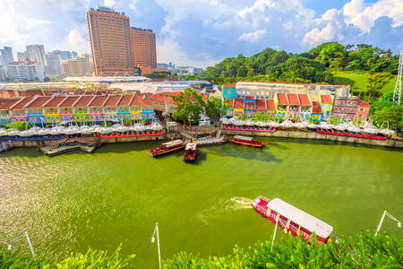 Photo for Daylight aerial view of Clarke Quay in Riverside area of Singapore, Southeast Asia. Cruise boat on Singapore River skyline in the sun. - Royalty Free Image