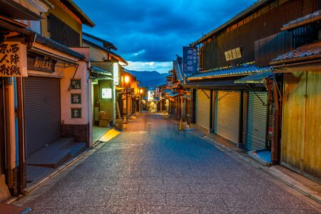 Photo for Kyoto, Japan - April 24, 2017: the ancient street of Hanami Lane or Hanamikoji Dori in the Gion District, at World Heritage at dusk. Gion is Kyotos most famous geisha district located in Kyoto, Japan - Royalty Free Image