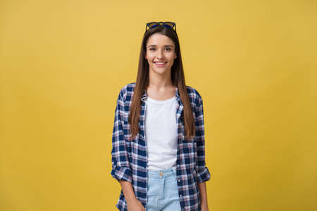 Photo pour Headshot Portrait of happy girl with freckles smiling looking at camera. Isolated over yellow background. - image libre de droit