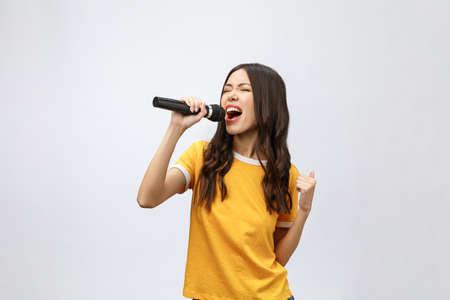 Photo pour beautiful stylish woman singing karaoke isolated over white background. - image libre de droit