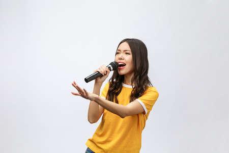 Foto per beautiful stylish woman singing karaoke isolated over white background. - Immagine Royalty Free