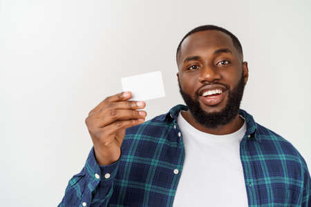 Photo pour Business Concept - Happy handsome professional african american businessman giving name card to client - image libre de droit