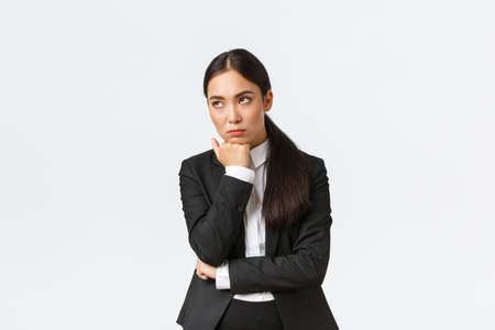 Photo pour Bored and annoyed female entrepreneur looking unamused away while sitting boring meeting, attend uninteresting office gathering, standing white background dying boredom - image libre de droit