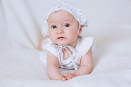 Photo for Funny little girl in a hat on a white background - Royalty Free Image