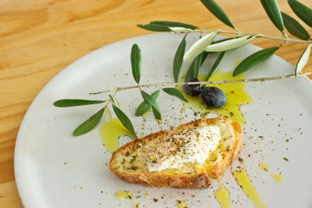 Appetizer with bread olive oil and cheese