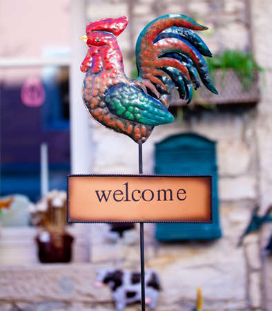 Welcome sign with iron rooster