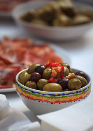 Fresh olives and other food in the cups