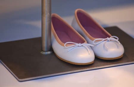 View of white and pink female shoes