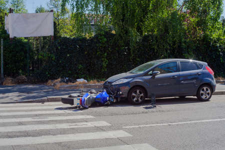 Scooter crash in the urban street, Milan