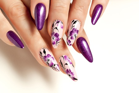 Nail art service. Female manicure and floral patterns.の写真素材