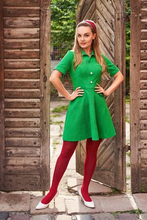 Photo for Young beautiful girl dressed in retro vintage style feeling confident standing in the doorway - Royalty Free Image