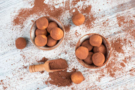 Photo for Marzipan potatoes, in german called Marzipankartoffeln, with cacao powder, sweets for christmas, empty copy space - Royalty Free Image