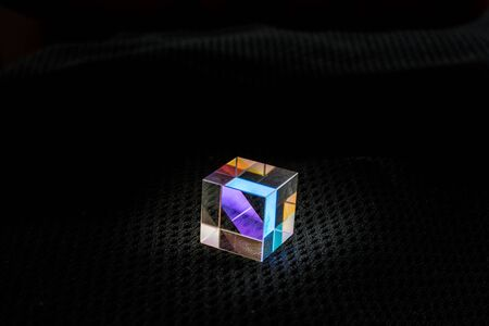 Photo for Optical glass cube Light dispersion,spectrum. Physics optics ray refractions - Royalty Free Image