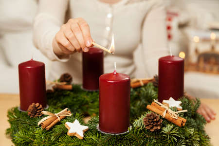 Foto per Kindle first candle on the first Advent - Immagine Royalty Free
